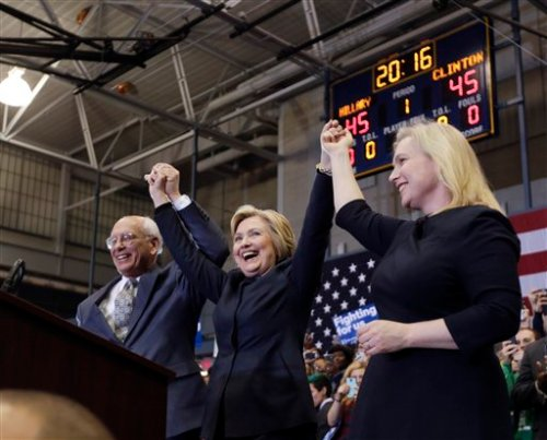 Democratic presidential candidate Hillary Clinton, center, stands with Rep. Paul Tonko, D-N.Y., and Sen. Kirsten Gillibrand, D-N.Y., after speaking at a rally at Cohoes High School on Monday, April 4, 2016, in Cohoes, N.Y. (AP Photo/Mike Groll)