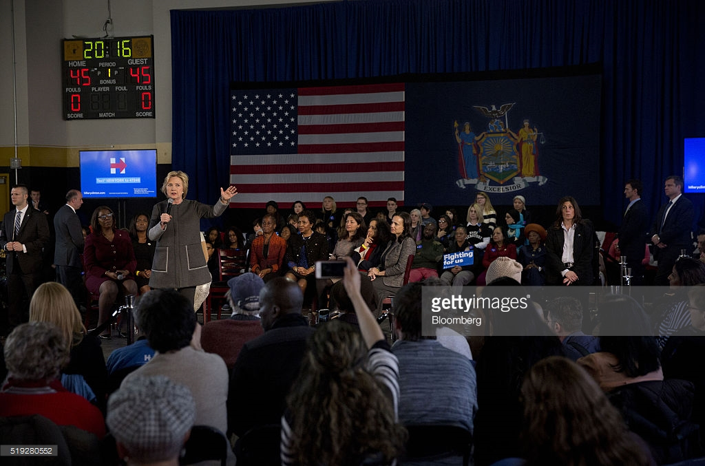 "Hillary Clinton, former Secretary of State and 2016 Democratic presidential candidate, speaks during a ""Women for Hillary"" town hall event at Medgar Evans College in Brooklyn, New York, U.S., on Tuesday, April 5, 2016. Clinton is becoming increasingly irritated by Bernie Sanders' pointed attacks that portray her as a tool of special interests, people close to her say, leading her to sharpen her approach to the primary at a time when she hoped to get a head start on the general election. Photographer: Victor J. Blue/Bloomberg *** Local Caption *** Hillary Clinton"