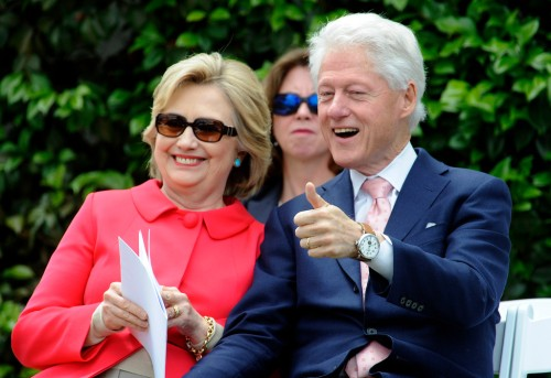 Former President Bill Clinton gives the thumbs-up as Democratic presidential candidate Hillary Clinton smiles during the Loyola Marymount 2016 Commencement on the campus of Loyola Marymount University on Saturday, May 7, 2016 in Los Angeles. (Photo by Libby Cline)