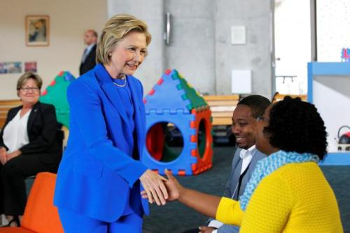 "U.S. Democratic presidential candidate Hillary Clinton shakes hands with parents during a campaign event, ""Conversation with Young Parents in the Workforce"" at The Family Care Center in Lexington, Kentucky, U.S., May 10, 2016. REUTERS/John Sommers II"
