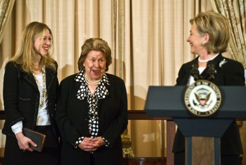 US Secretary of State Hillary Clinton (R) looks back at her mother Dorothy Rodham (C) and daughter Chelsea as she speaks after being ceremonially sworn in at the State Department in Washington on February 2, 2009. AFP PHOTO/Nicholas KAMM (Photo credit should read NICHOLAS KAMM/AFP/Getty Images)