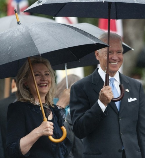 US Vice President Joe Biden and Secretary of State Hillary Clinton smile as US President Barack Obama welcomes South Korean President Lee Myung-bak during a State Arrival Ceremony on the South Lawn of the White House in Washington, DC, on October 13, 2011. Obama hosts his South Korean counterpart for a full day of official State ceremonies, including a State Dinner. AFP PHOTO / Saul LOEB (Photo credit should read SAUL LOEB/AFP/Getty Images)