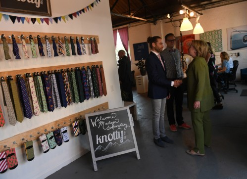 DENVER, CO - AUGUST 3: Democratic presidential nominee Hillary Clinton, right, meets Jeremy Priest, left, and Mark Johnson, middle, co-founders of Knotty Tie Company on August 3, 2016 in Denver, Colorado. The company makes it's custom ties, scarves and bowties in the United States while employing legal immigrants from all over the world. The company seeks to build and create meaningful employment opportunities for resettled refugees. (Photo by Helen H. Richardson/The Denver Post)