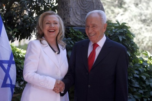 JERUSALEM, ISRAEL - JULY 16: (ISRAEL OUT) Israeli President Shimon Peres (R) shakes hands with US Secretary of State Hillary Clinton before their meeting on July 16, 2012 in Jerusalem, Israel. Clinton is in Israel to discuss diplomacy with Iran, Syria and Egypt in addition to peace talks regarding the Middle East. (Photo by Lior Mizrahi/Getty Images)