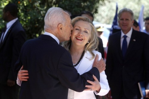 JERUSALEM, ISRAEL - JULY 16: (ISRAEL OUT) Israeli President Shimon Peres (L) kisses US Secretary of State Hillary Clinton before their meeting on July 16, 2012 in Jerusalem, Israel. Clinton is in Israel to discuss diplomacy with Iran, Syria and Egypt in addition to peace talks regarding the Middle East. (Photo by Lior Mizrahi/Getty Images)