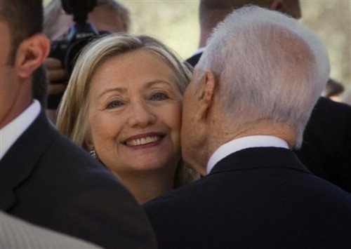 US Secretary of State Hillary Rodham Clinton, left, is greeted by Israeli President Shimon Peres, as she arrives at the Israeli presidential residence in Jerusalem, Wednesday, Sept. 15, 2010. Clinton is in the region for peace talks between Israeli and Palestinian leaders and will try to defuse a looming crisis over Israeli settlement construction. (AP Photo/Bernat Armangue)