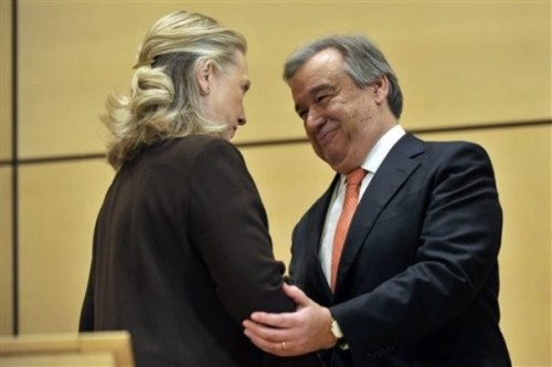 Hillary Rodham Clinton, left, Secretary of State of the United States of America shakes hands with United Nations High Commissioner for Refugees Antonio Guterres, right, during the UNHCR Intergovernmental event at the ministerial level of Member States of the United Nations, at the European headquarters of the United Nations in Geneva, Switzerland, Wednesday Dec. 7, 2011. (AP Photo/Keystone/Martial Trezzini)